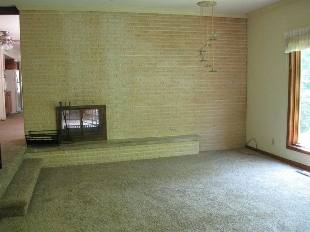 One Of The Great Features Home Is A Sunken Living Room With Brick Fireplace Transforming Space From 1960s Modern To More Transitional