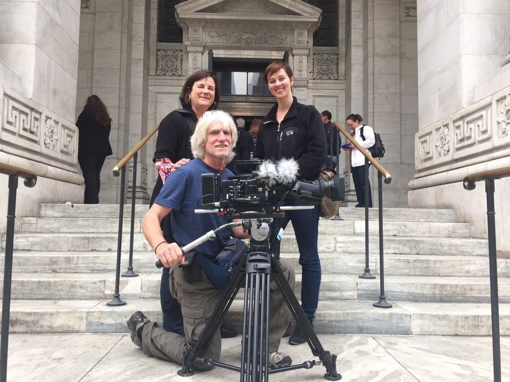 Director Dawn Logsdon, Associate Producer Ellie McCutcheon, and Director of Photography Vicente Franco filming on the steps of the New York Public Library.