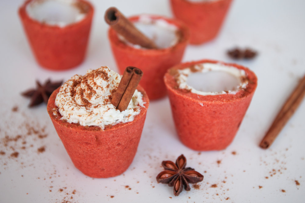 Spiked Apple Cider  - Pair with a Jack-O-Lantern or Pumpkin Spice Cookie Cup 4 oz. Apple Cider 2 oz. whiskey Whisk together in large bowl and spoon into Cookie Cup of your choice.  Top with a dollop of whipped cream, a sprinkle of cinnamon and a fresh cinnamon stick for a wow factor.  Fills approximately 4 cookie cups