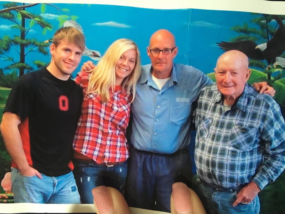 My husband, Me, My Dad, and My Grandpa back in 2013 in a prison near Cincinnati.