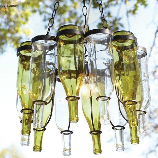 Wouldn't this be an amazing statement piece? Especially in an area with a bar. #designinspiration #lighting #bardesign #winebottles