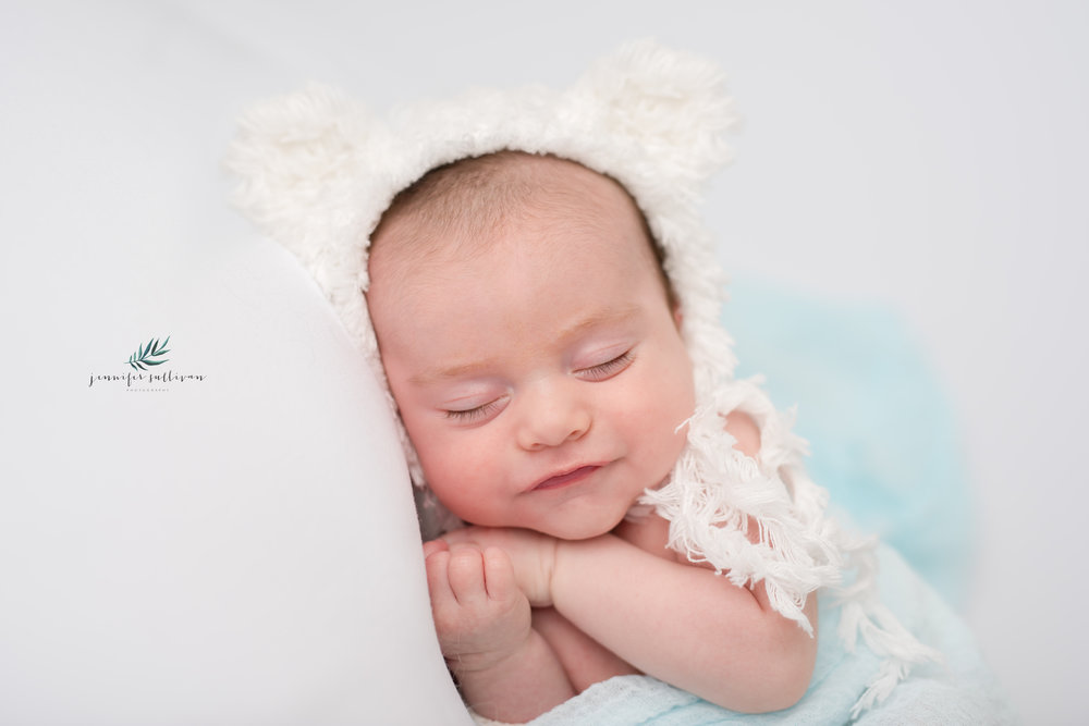 Emmett came to see me at 7 weeks old for his Newborn portrait session. At first, I wasn't sure if I was going to get him to sleep (and keep him asleep) to get him in some sweet little poses but if finally happened. See that sweet little smile here. I wonder what he is dreaming about.