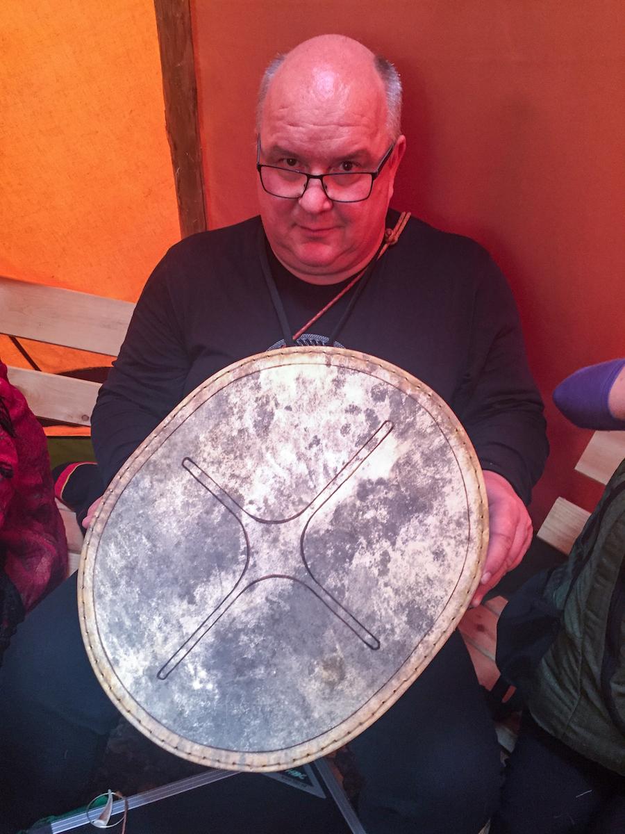 Krister Stoor holds a Sámi drum.