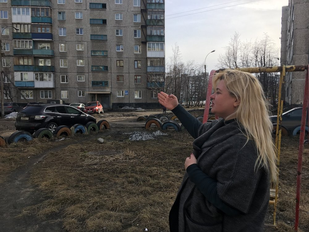 Anna Kireeva near some of the Soviet-era apartment blocks