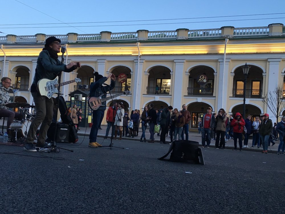 Musicians perform in the street.