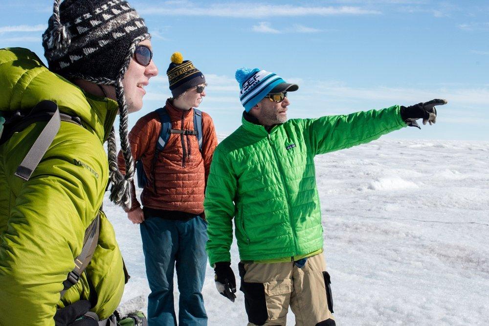 Graduate student Ian MacDowell, undergrad Aidan Stansberry, and principal investigator Joel Harper at work on the Greenland ice sheet