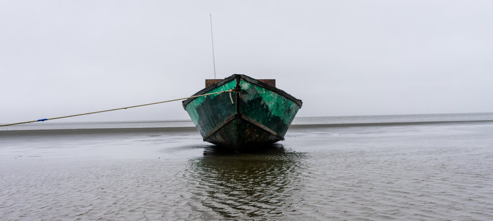 A boat floats off the coast of Shishmaref.