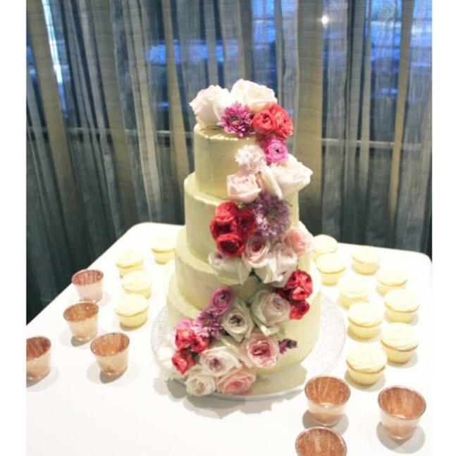 Cascading fresh flowers wedding cake