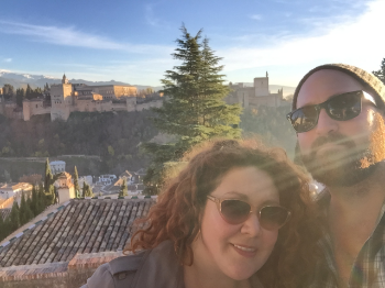 "Meg and her brother Tim at the Alhambra.  Now, they enjoy traveling together, but growing up, their age gap could be a challenge. Meg recalls, ""My brother, Tim, is almost nine years younger than me so when there was a baby or a toddler at the house, I just wanted to escape."""