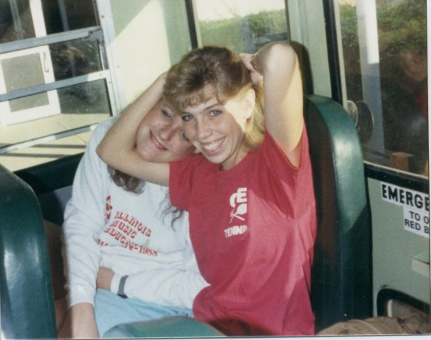 "Stephanie (right) in her varsity tennis shirt on the school bus during high school. She played doubles and recalls, ""I had a great partner and we just had a ball."""