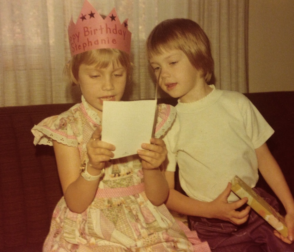 Stephanie (in the crown) on her 6th birthday, getting a book from her best friend Beth.