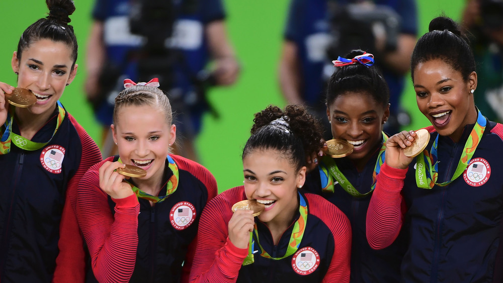 "The ""Final Five"" and their medals. Photo: Getty Images"