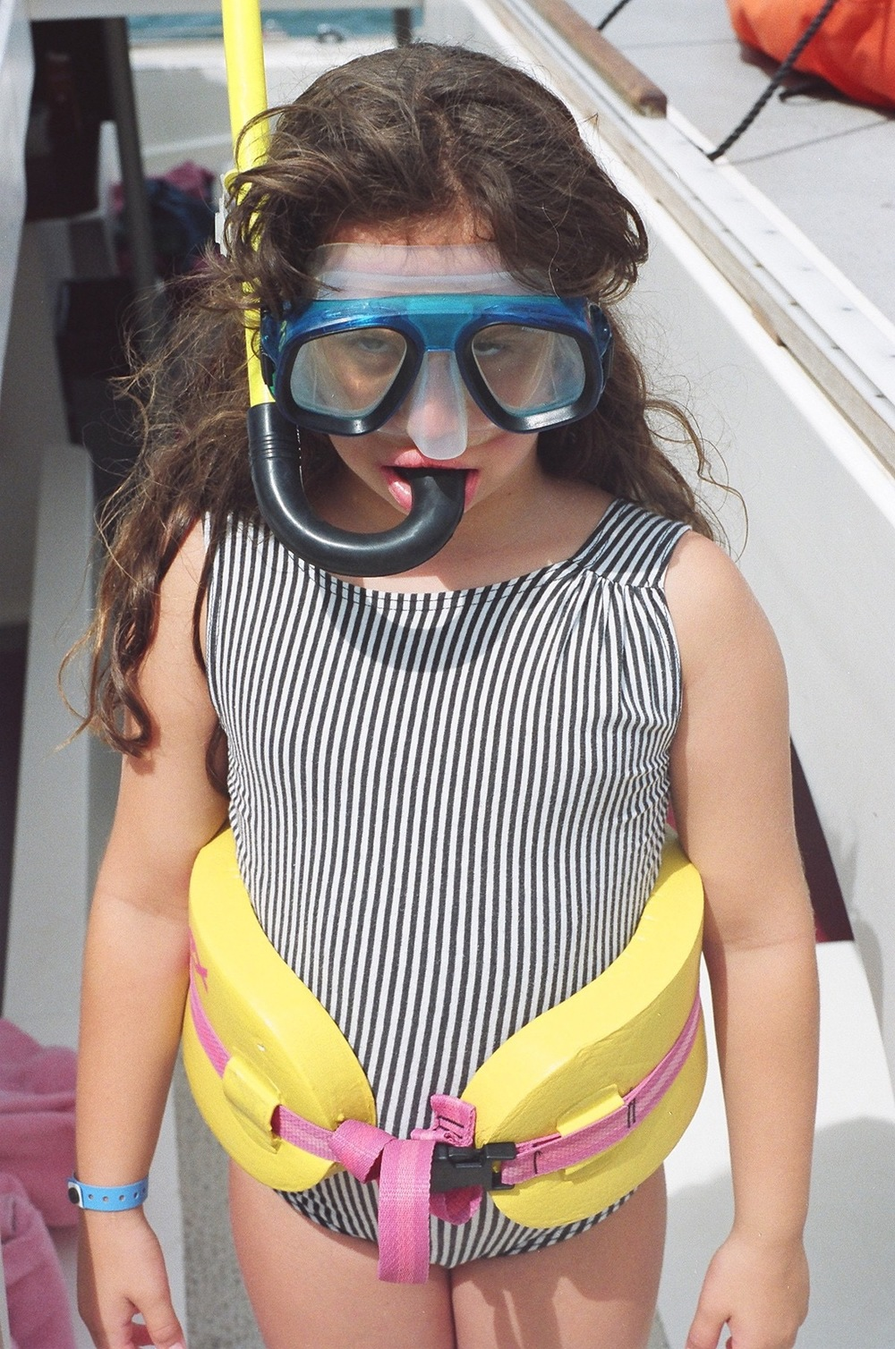 Lizy as a girl throwing major shade as she gets ready for some snorkeling.