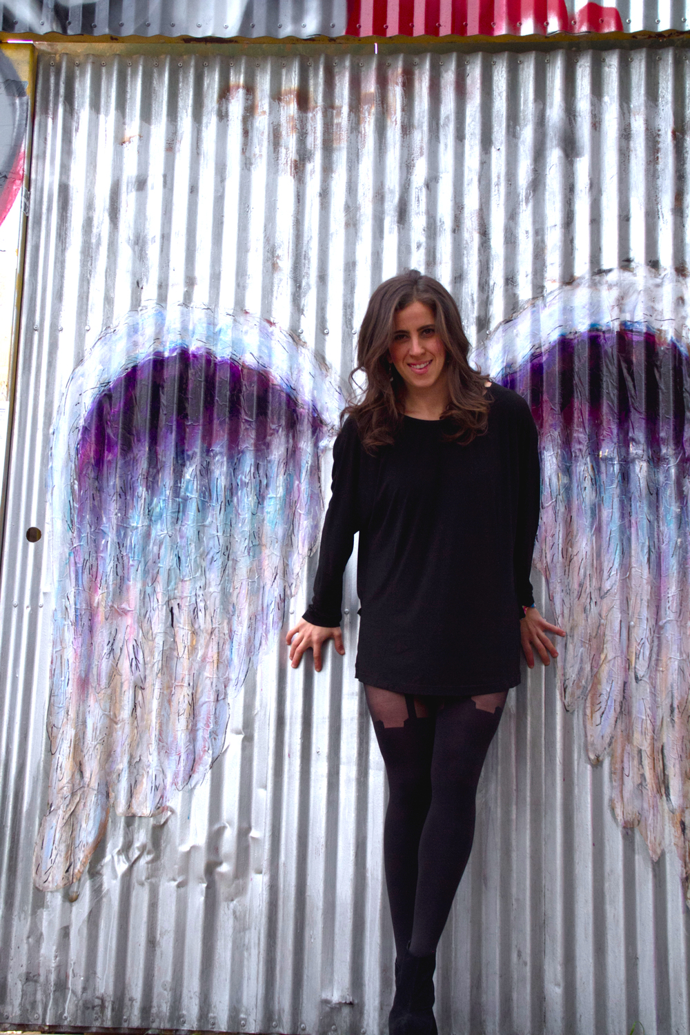 Lizy has formed collaborative relationships with some of the artists she interviews. Colette, the creator of these angel wings, is one of them.