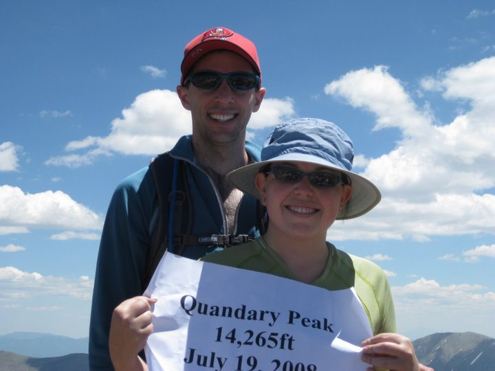 Julie and her family love to enjoy Colorado's outdoors. Here, she and her husband Sam are atop one of Colorado's 14ers- mountains over 14,000 feet in elevation.