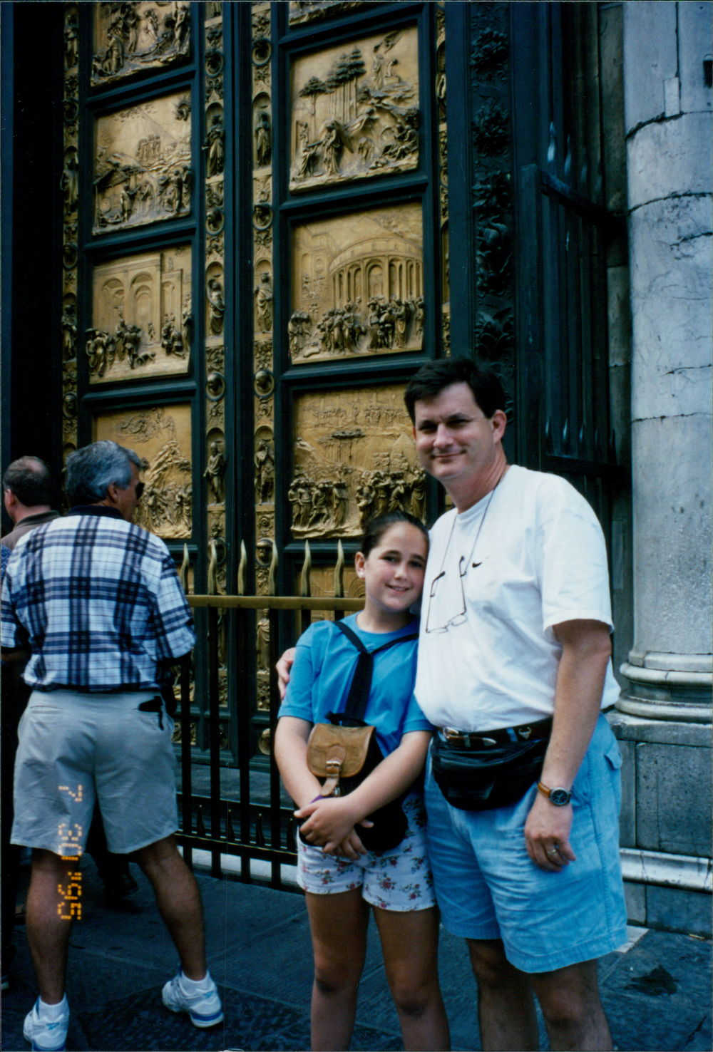 Beth and her dad in front of Ghiberdi's Gates of Paradise in Florence.