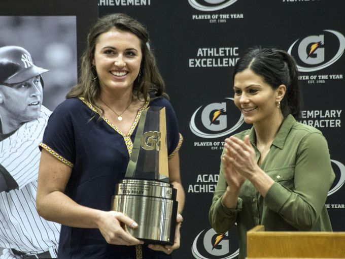 Keri gets to present Gatorade Players of the Year with their awards. She's here with Erin Boley, this year's winner for girls basketball.  (Image courtesy of the  Courier-Journal )