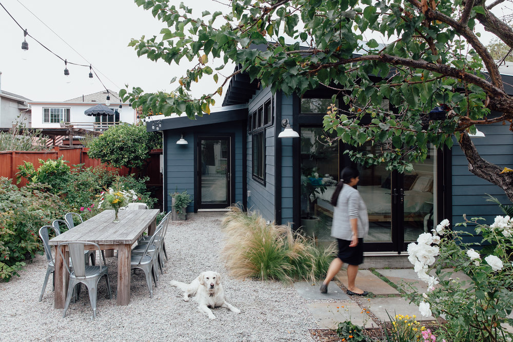 Ming outside a tiny house Atelier Cho Thompson designed for an Oakland, CA family.