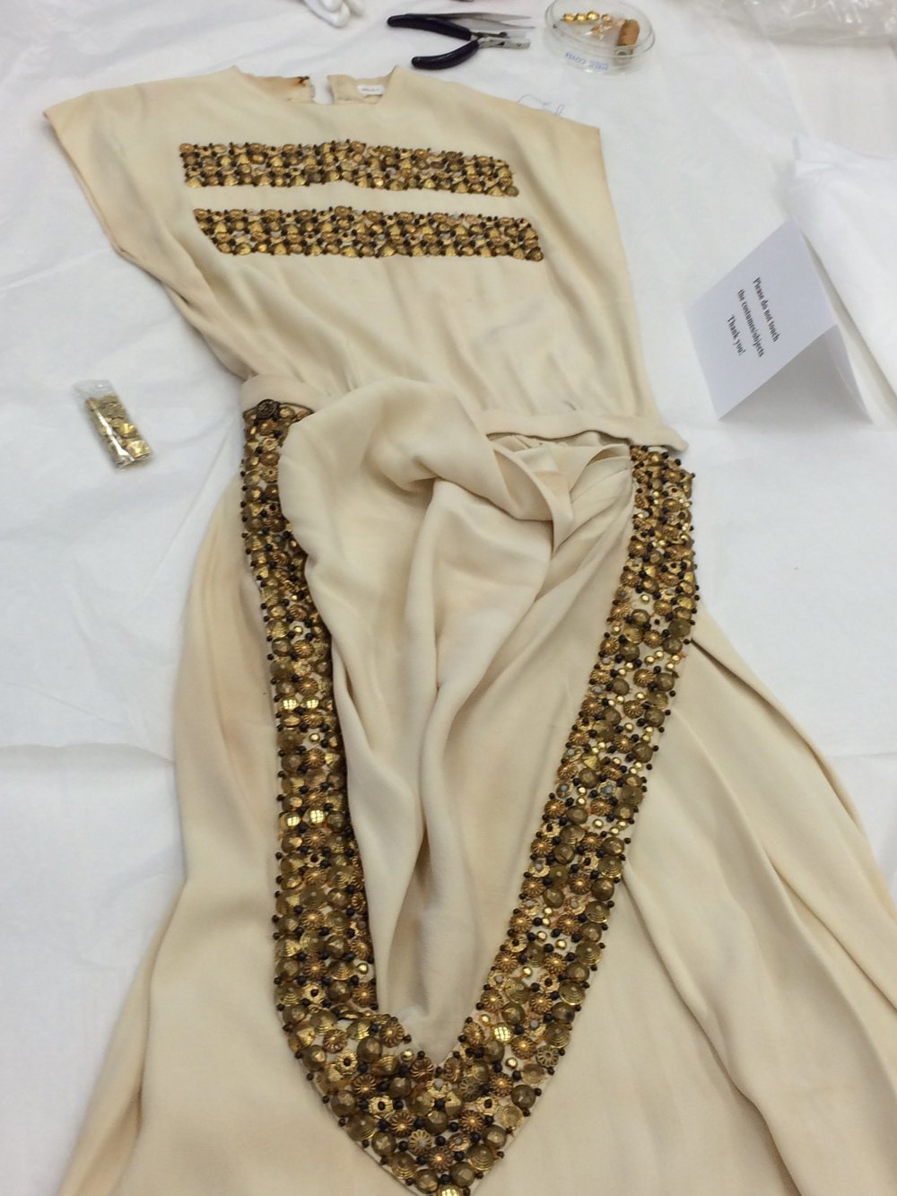 The dress had to be cleaned and repaired before it could be displayed.
