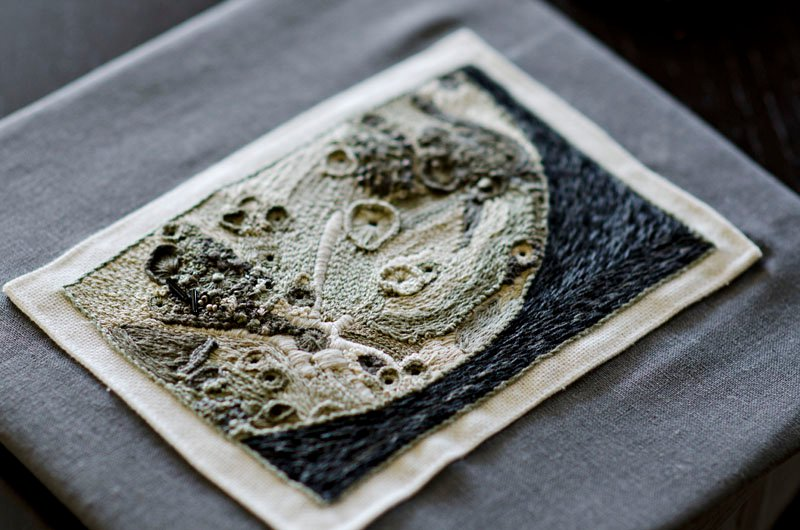 Rachel made this embroidery of the moon's surface. Chatting with a NASA employee at a Maker Fair, she learned about a contest NASA and Etsy were organizing for space-themed crafts. She won in the 2-D design category, and a picture of her work went up on the space shuttle!