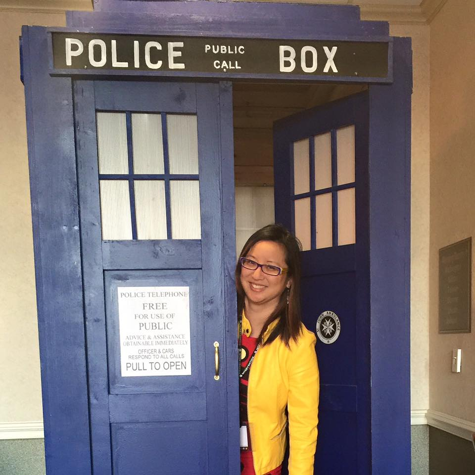 Amy attends a lot of conventions to show her work and network with editors, publishers, artists, and the comic book community.. Here she's having a little fun at the entrance to Dr. Who's TARDIS.