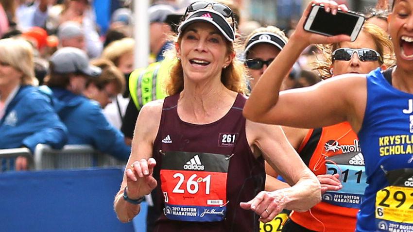 Kathrine Switzer, again wearing bib 261, crossing the finish line at Monday's Boston Marathon. ( Photo via The Boston Globe )