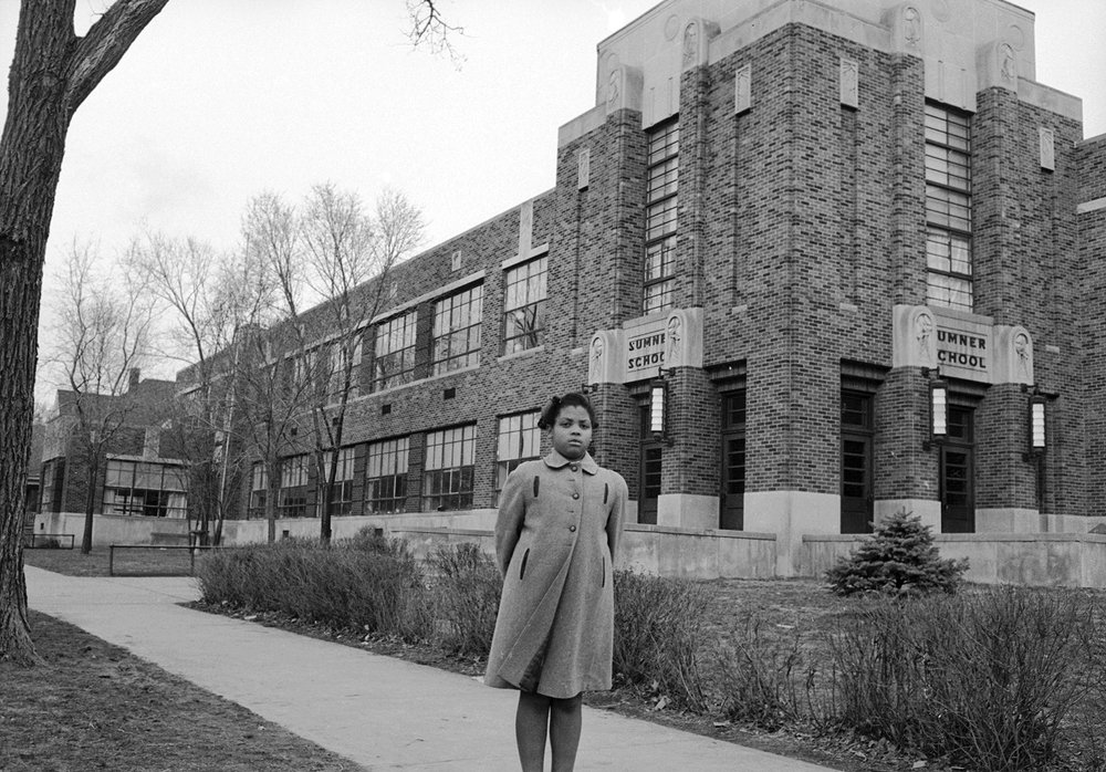 Linda Brown outside the neighborhood elementary school that denied her enrollment.