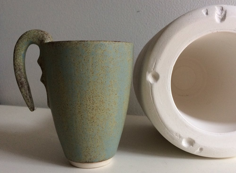 Custom cup with plaster 'drop-out' mould