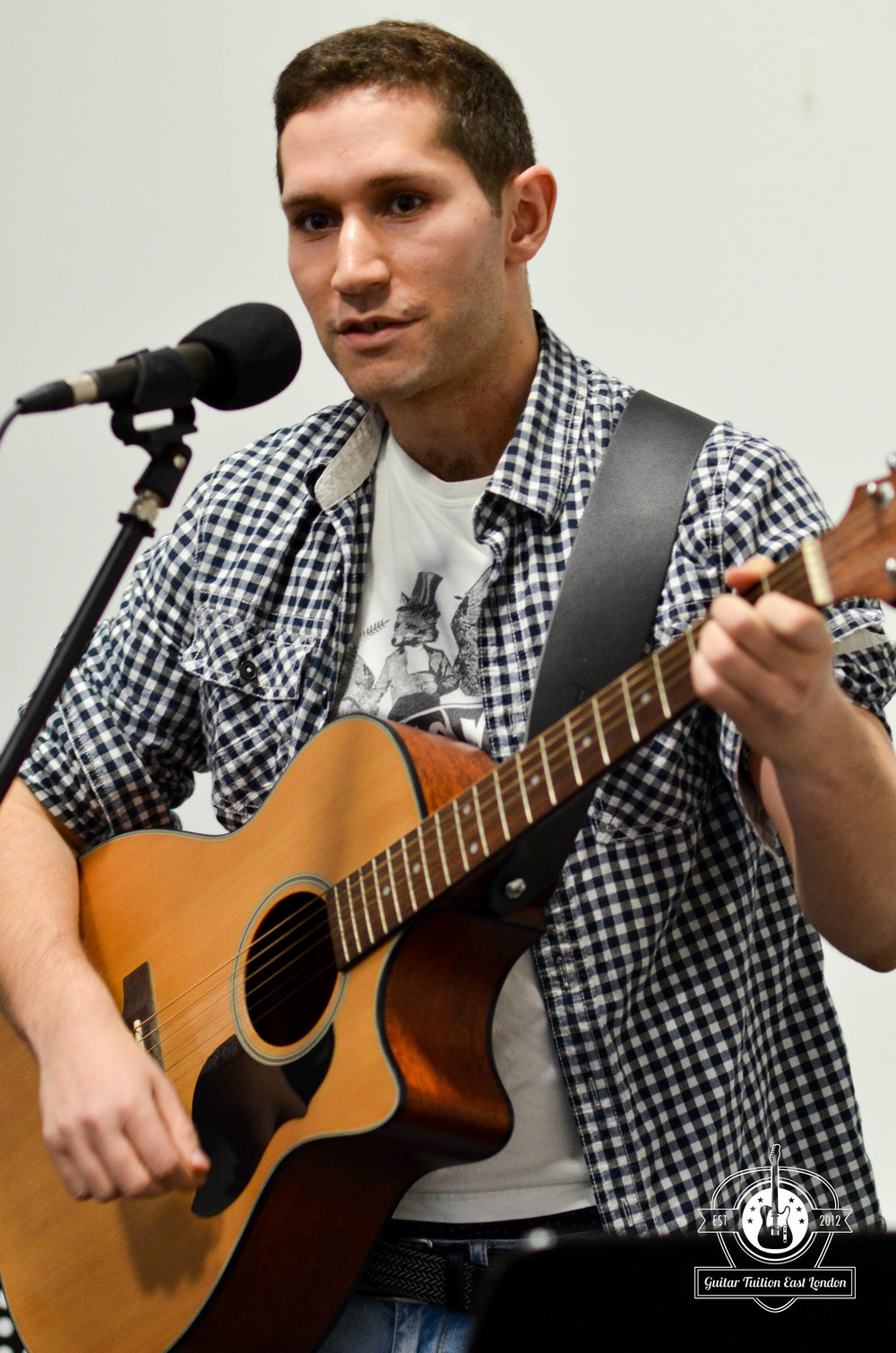 Jon, performing a song for us in this photo. He started as a beginner at Guitar Tuition East London and has developed so much confidence since then and achieved his dream of playing at Open Mics.
