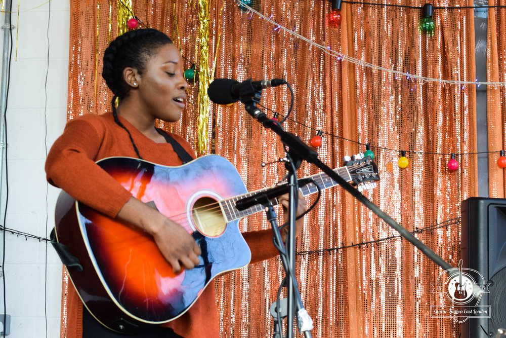 Chardelle, our student who is performing at an Open Mic, and is now writing her own songs as well! She started as a near beginner and while she had been to a different guitar in London, since she's been with us. She's been thrilled with the results and the confidence she's gained in lessons and the amazing people she has met and are now performing and writing music with.
