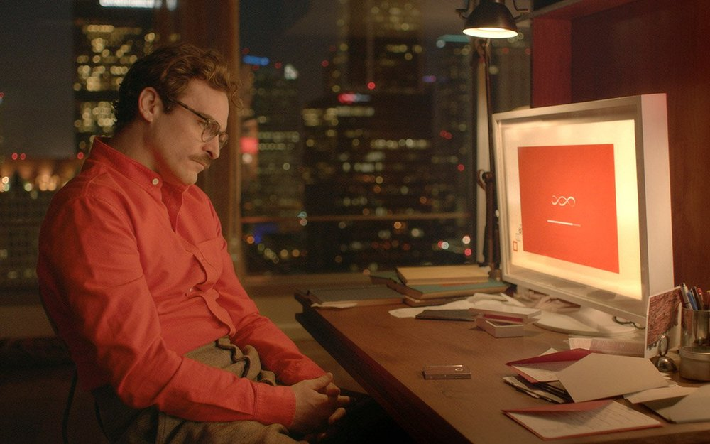 "Joaquin Phoenix in the movie ""Her"", communicating with technology solely through voice (Source: www.agoodmovietowatch.com)."