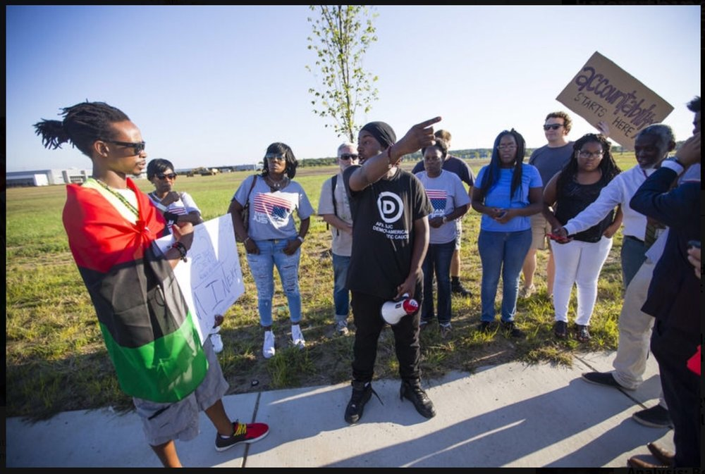 A picture from yesterday's protest at the SBPD station. The protest was led by members of the Nu Black Power Movement, and was organized to call for the firing of Officer Aaron Knepper. Photo credit: Michael Caterina,  South Bend Tribune