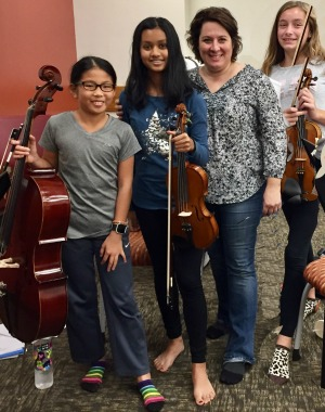 Coach Kathy Melucci with members of the 2017-18 Barefoot Quartet.