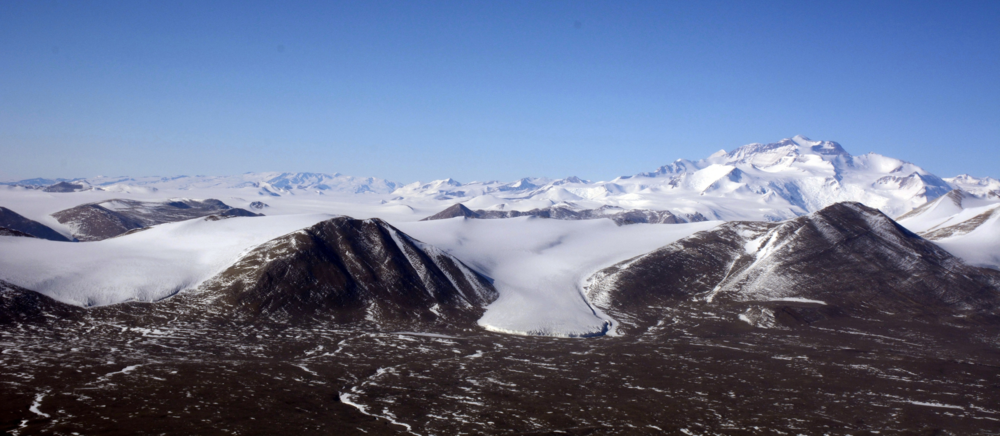 An aerial view of the McMurdo Dry Valleys, a 15,000-square-kilometer cold desert in Antarctica. Life persists here at the very limits of existence amid unique geological, hydrological, climatic conditions. Photo:  Peter Rejcek, NSF, USAP.