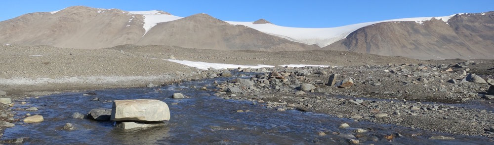 Glacial meltwater flows along the lower reaches of Von Guerard stream, near our camp on the shores of Lake Fryxell, Taylor Valley, Antarctica.
