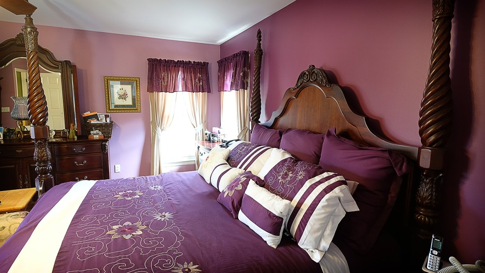 Mauve rose color walls with matching four poster king size bedding and window treatments - Residential painting by Nash Painting Nashville TN