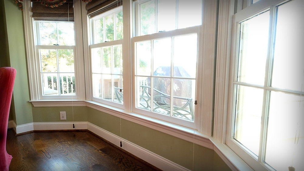 Light green walls, large bay window in dining room looking out on the deck - Residential painting by Nash Painting Nashville TN
