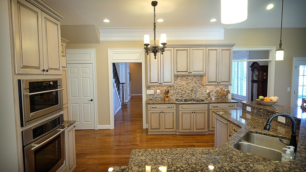 Light tan, taupe large kitchen with white trim and hardwood floors - Residential painting by Nash Painting Nashville TN