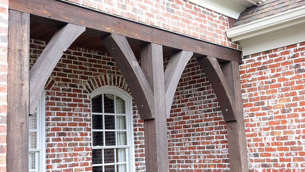 Exterior wood trim staining, front porch area on a brick home - Residential painting by Nash Painting Nashville TN