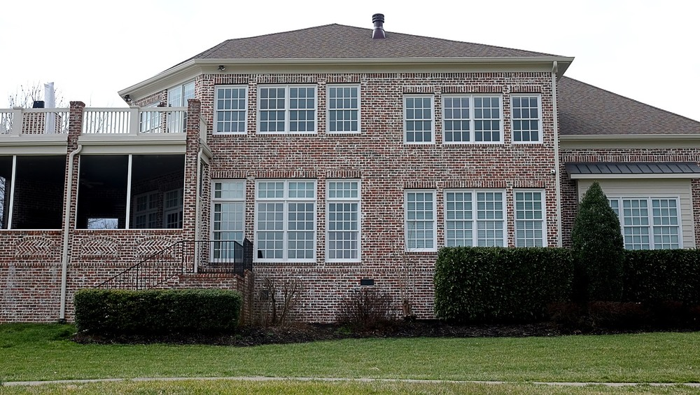 Exterior trim painting on a brick home - Residential painting by Nash Painting Nashville TN