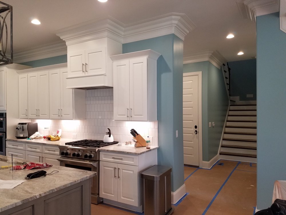 Blue kitchen with white cabinets - Residential painting by Nash Painting Nashville TN