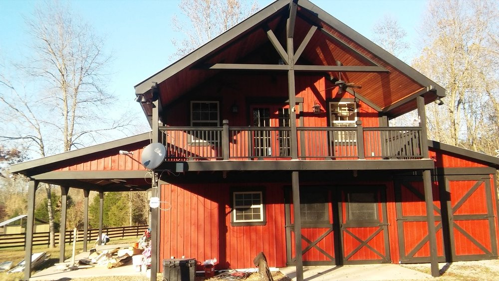 Exterior red and black paint on barn-style home - - Residential painting by Nash Painting Nashville TN