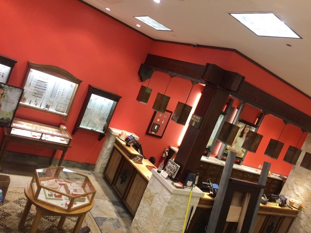 Red store with black trim on display cases - Residential painting by Nash Painting Nashville TN