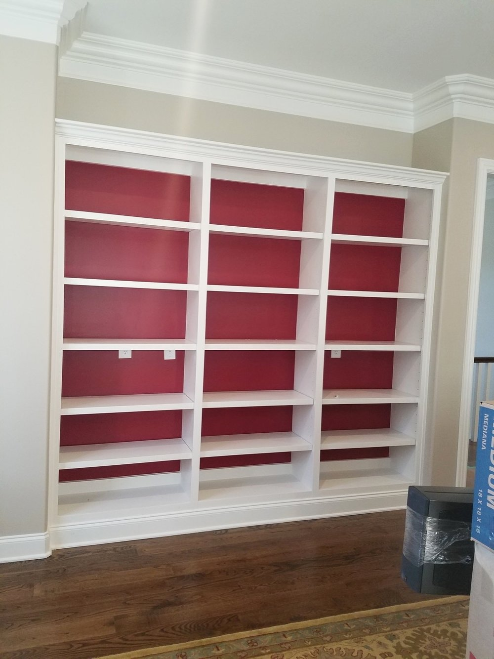 White shelves with red wall - Residential painting by Nash Painting Nashville TN