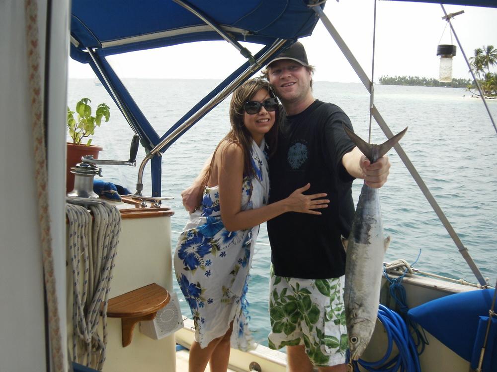 Happy guy with pretty girl & Spanish mackeral website.JPG
