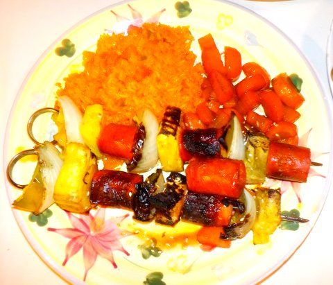 Chirizo shishkabobs served with coconut rice and honey glazed carrots