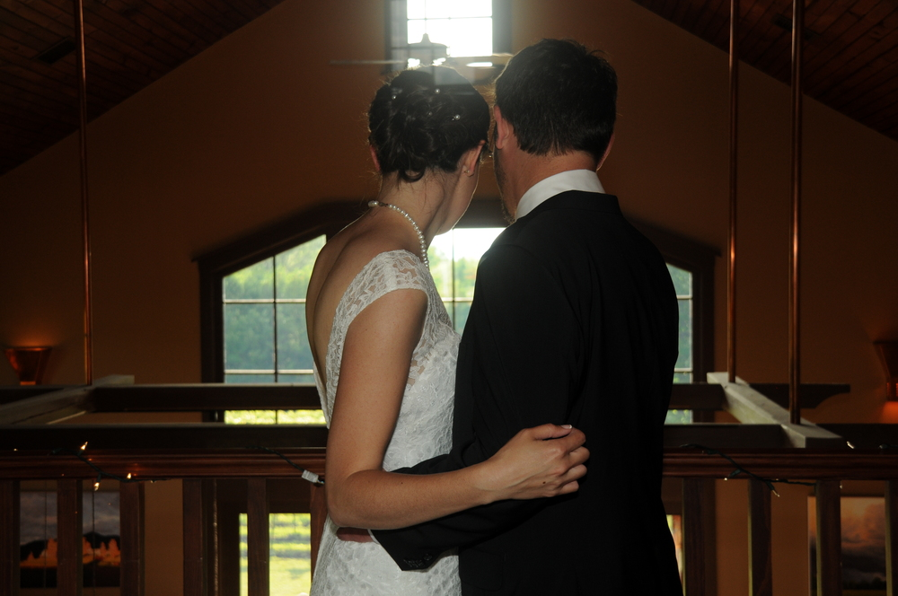 bride and groom overlooking the tasting room.jpg