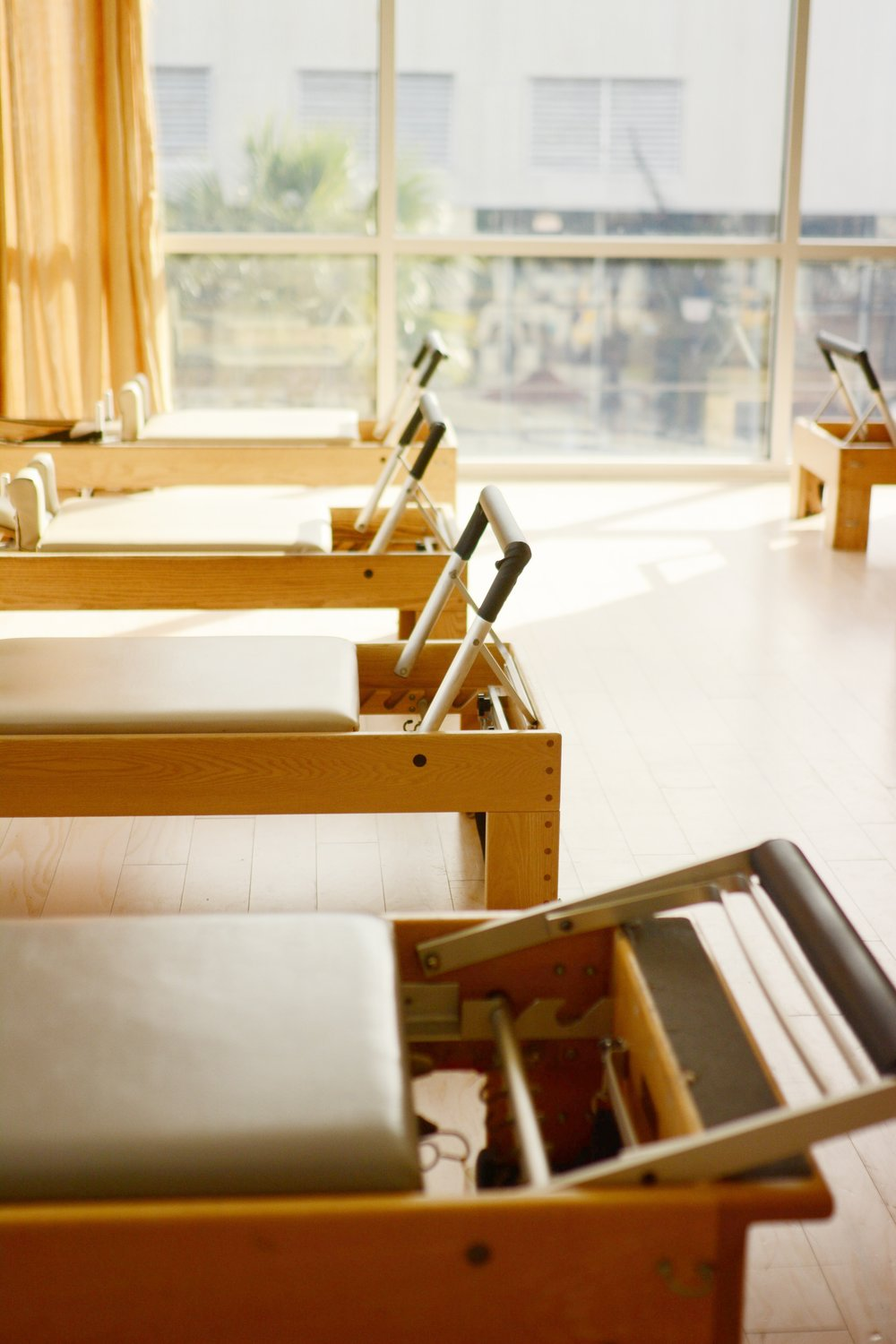 Reformer - The Pilates Reformer is perhaps the most well-known piece of Pilates equipment.  In essence it is a sled with spring attachments, ropes, and straps.  The spring resistance can assist or resist muscular patterns in order to facilitate neuromuscular re-education.
