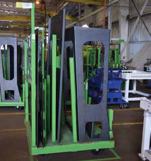 All items for one cab are kitted out on a custom designed carrier to move them from bending to welding.