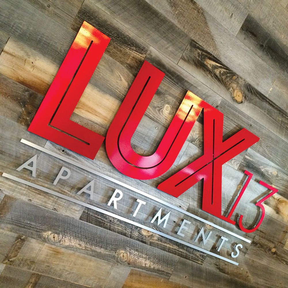 neutral7 design large format printing lux13 apartments lobby sign metal logo signage